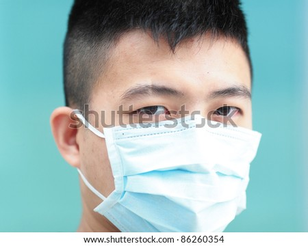 man with facemask - stock photo