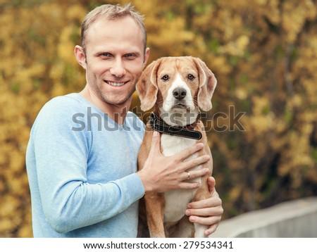 Man with favorit beagle dog pet handsome portrait - stock photo
