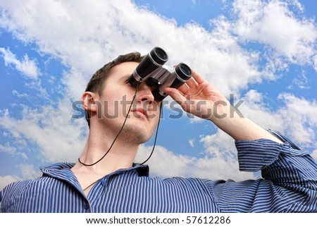 Man with field-glass - stock photo