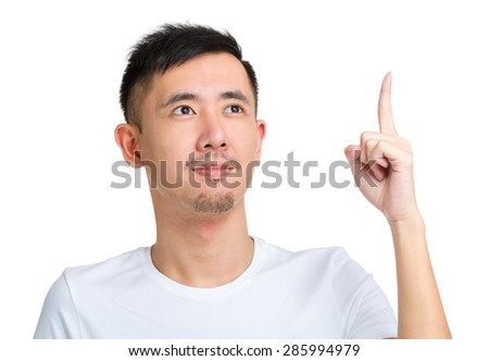 Man with finger point up and look away from camera - stock photo