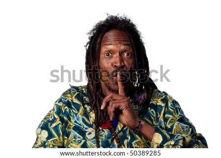 Man with fingers on his lips, telling people to be quiet - stock photo