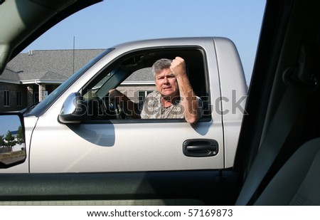man with fist in the air showing symptoms of road rage