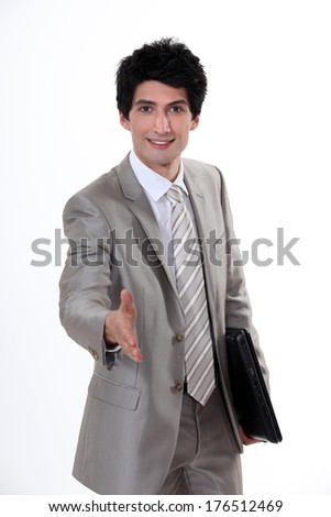 Man with folder offering to shake hands - stock photo
