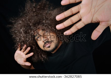 Man with funky hairstyle gives a stylish pose - stock photo