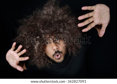 Man with funky hairstyle gives a stylish pose