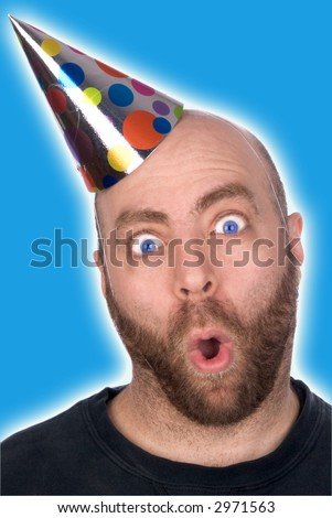 Man with Funny expression wearing a party hat isolated over blue - stock photo