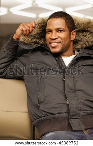 Man with Fuzzy hood on - stock photo