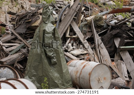 Man with gas mask and green military clothes    after chemical disaster. - stock photo