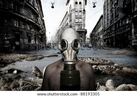 Man with gas mask in a landscape catastrophic - stock photo