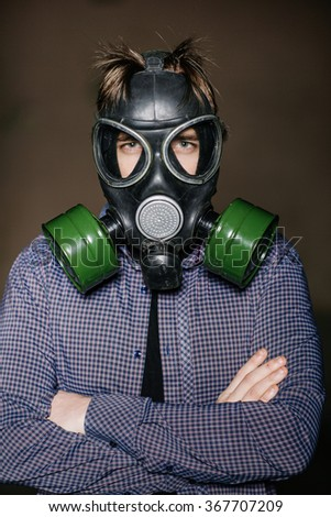 Man with gas mask looking at the camera - stock photo