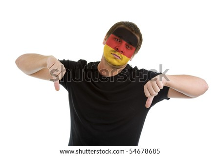 man with german flag painted on his face showing two thumbs down, isolated on white background - stock photo