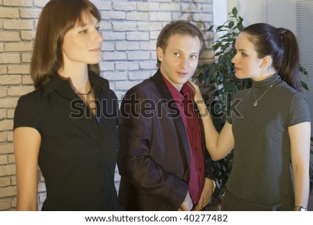 man with girlfriends looking at another woman - stock photo
