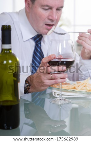 man with glass of red wine at restaurant - stock photo