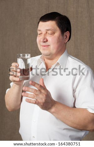 Man with glass of water.