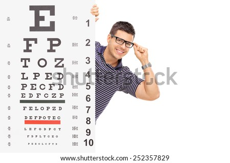 Man with glasses posing behind an eyesight test isolated on white background - stock photo