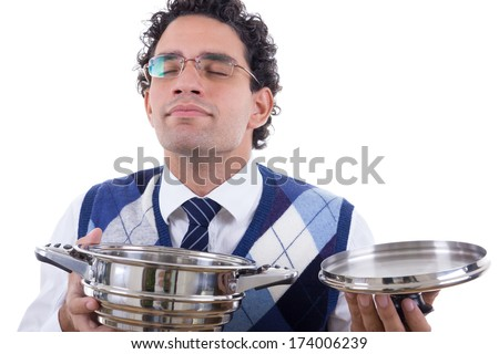 man  with glasses smelling delicious lunch from pot - stock photo