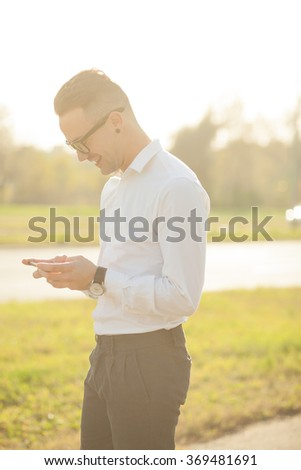 Man with glasses speak on mobile phone, In City, Urban Space, Park - stock photo