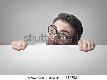 man with glasses who has a lot of fear - stock photo