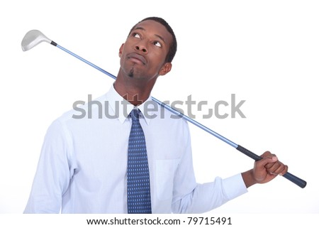 Man with golf club - stock photo
