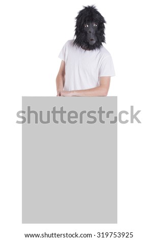 Man with gorilla mask holding a board - stock photo
