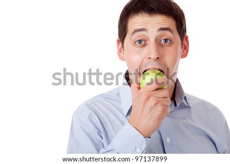 Man with green apple. - stock photo