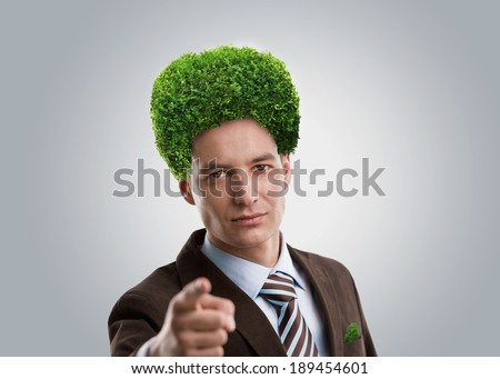 Man with green tree instead of hair. Ecological mind concept - stock photo