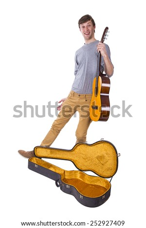 man with guitar on white background - stock photo