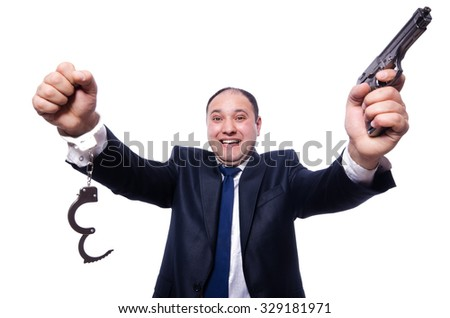 Man with gun and handcuffs on white - stock photo