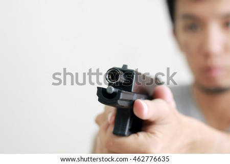 Man with gun close-up on white background
