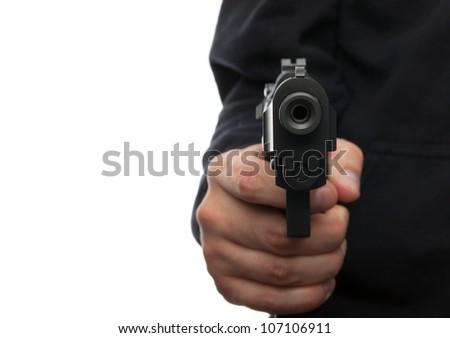 Man with gun, focus on the gun - stock photo