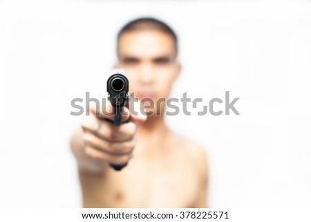 Man with gun, gangster, focus on the gun .gun has World war 2 - stock photo