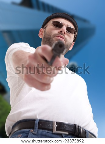 Man with gun in an urban environment