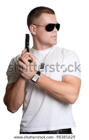 man with gun in sunglasses isolated on white - stock photo
