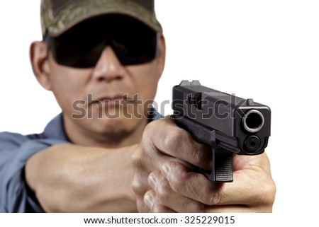 Man with Handgun Weapon Pointing on White Background. Studio props. Selective Focus. Professional law enforcement and executive personal protection services. - stock photo