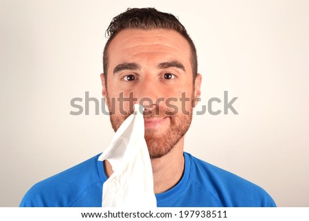 Man with handkerchief in the nose - stock photo