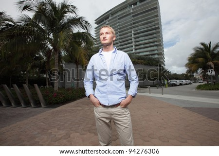 Man with hands in his pockets - stock photo