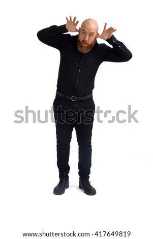 Man with hands on face Teasing - stock photo