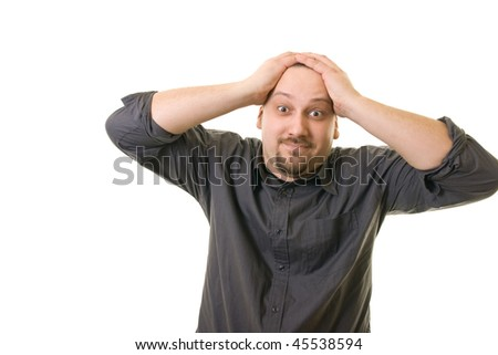 Man with hands on head - stock photo
