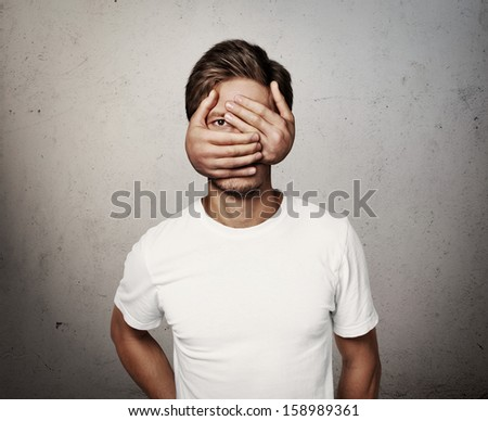 man with hands on his face - stock photo