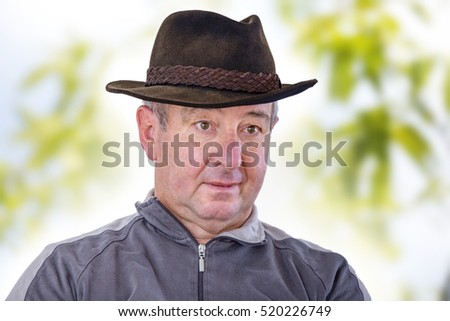 Man with hat as head cover