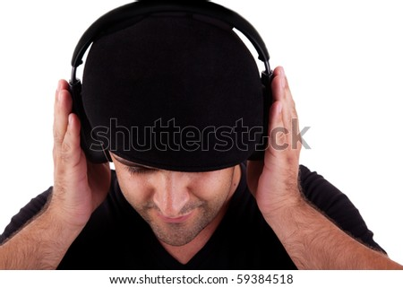 man with hat listening music in headphones, isolated on white background, studio shot - stock photo