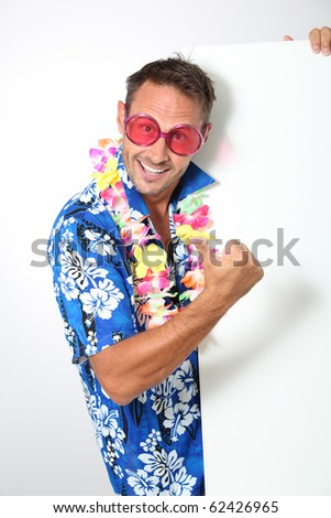 Man with hawaian shirt on white background - stock photo