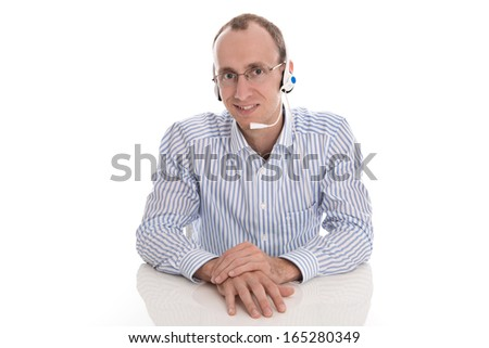 Man with head-set working in a call center - isolated on white.