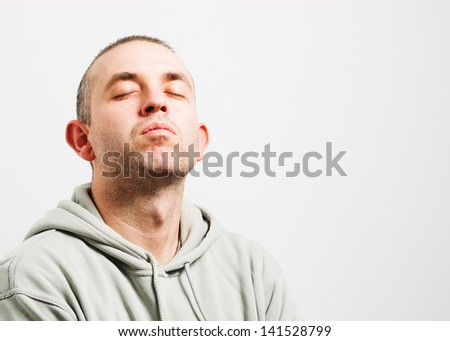 Man with head up and eyes closed isolated on white background