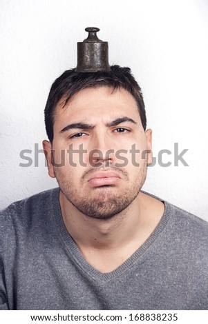 man with head weight - stock photo