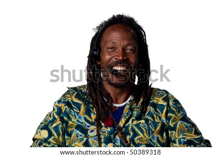 Man with headset smiling broadly, isolated image - stock photo