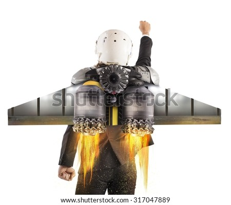 Man with helmet flies with powerful turbine - stock photo
