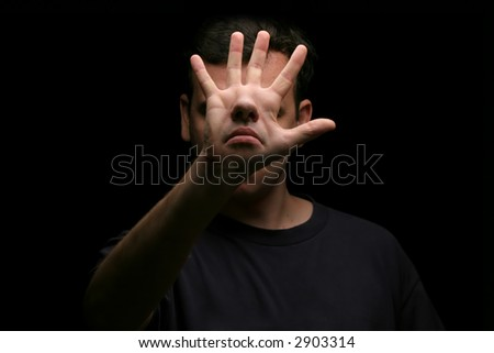 Man with hidden face  (face off) - abstract - art - stock photo