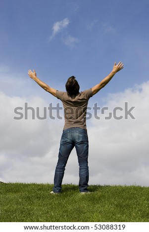 Man with his arms wide open enjoying life - stock photo