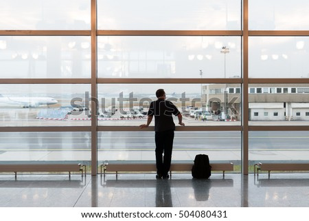 Man with his backpack waiting at airport terminal